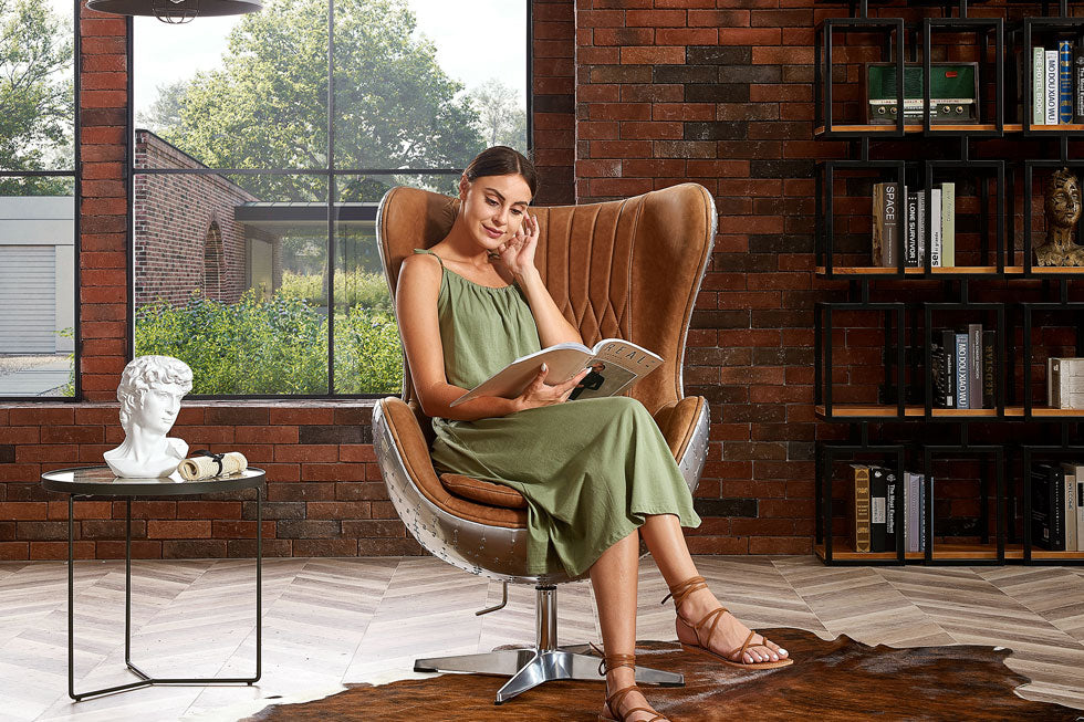 Modern industrial egg chair set in an urban space with exposed brick wall and vintage decor.