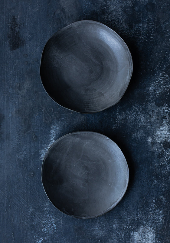 organic shaped black bowls shallow by clay beehive