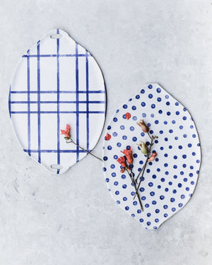blue and white patterned platters handmade by clay beehive ceramics