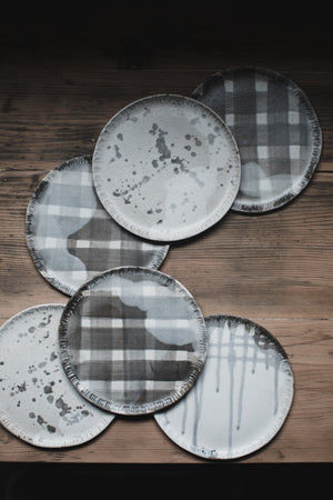 Patterned plates with carved rim by clay beehive