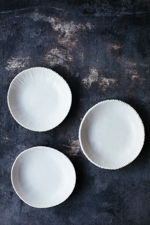 White bowls with detailed edging