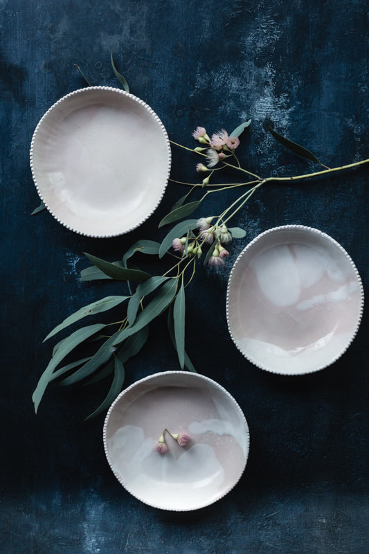 Pink and white bowls with detailed edging
