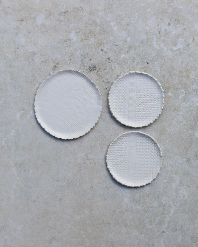 Satin white textured rim cake plates hand made by clay beehive ceramics