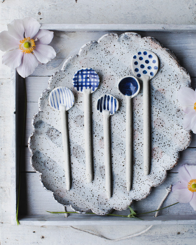 Blue and white hand made ceramic spoons by clay beehive