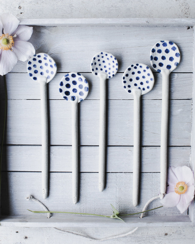 Hand made blue and white ceramic spoons with spots by clay beehive