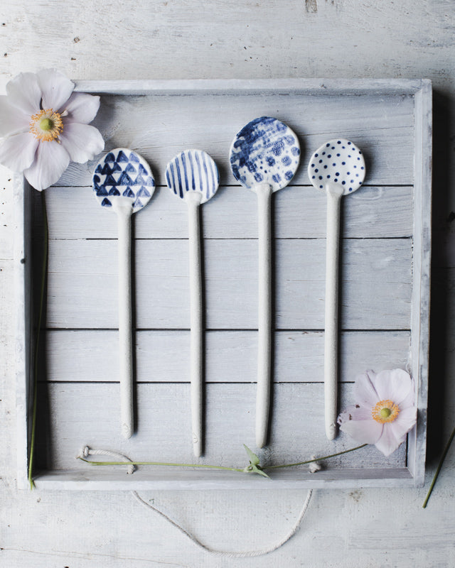 blue and white ceramic spoons by clay beehive ceramics