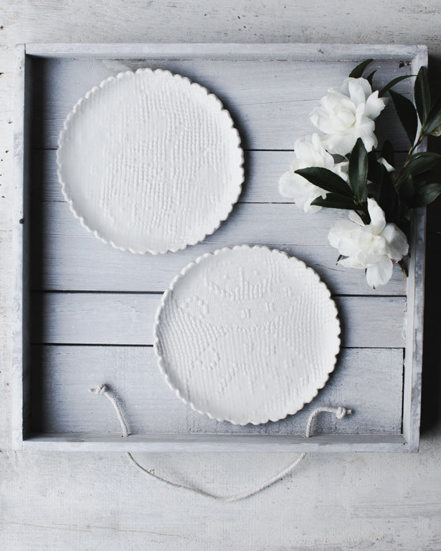 Scalloped rim white hand made plates with fabric texture by clay beehive ceramics
