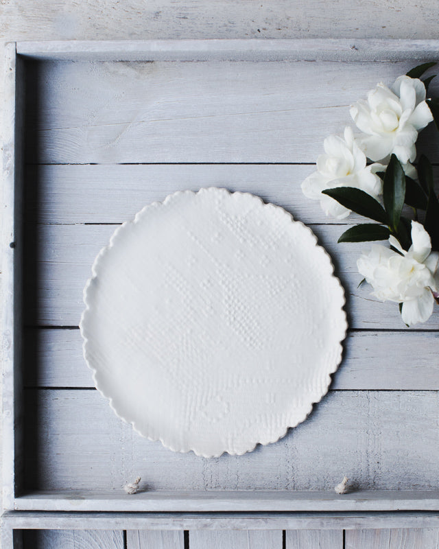 Scalloped rim handmade ceramic plate with textured fabric imprint by clay beehive
