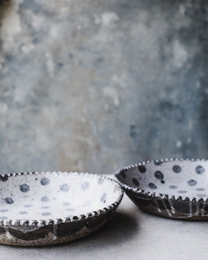 Rustic speckled bowls with scallop rim