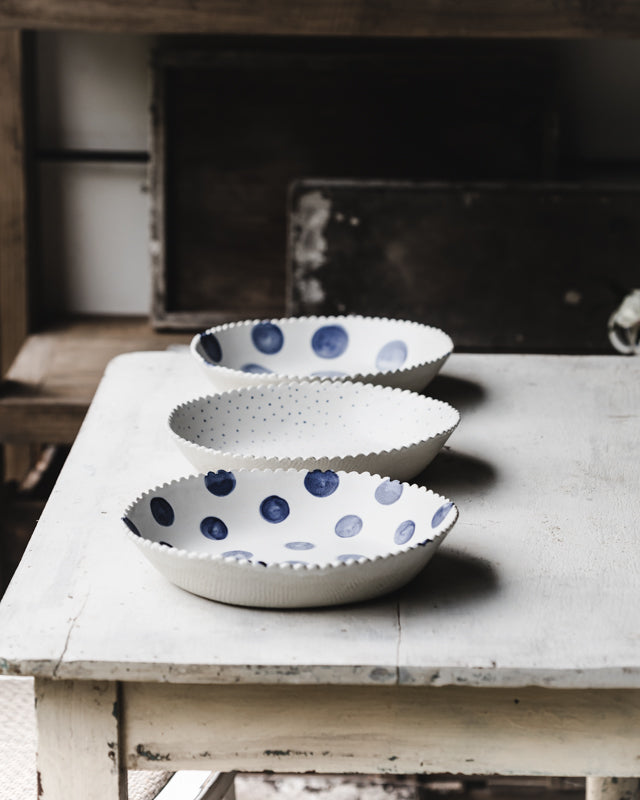 Navy and White large ceramic bowls with a blue spot and fabric textured exterior handmade by Clay Beehive