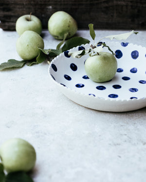 large hand made ceramic bowl with blue spots and satin white glaze by clay beehive