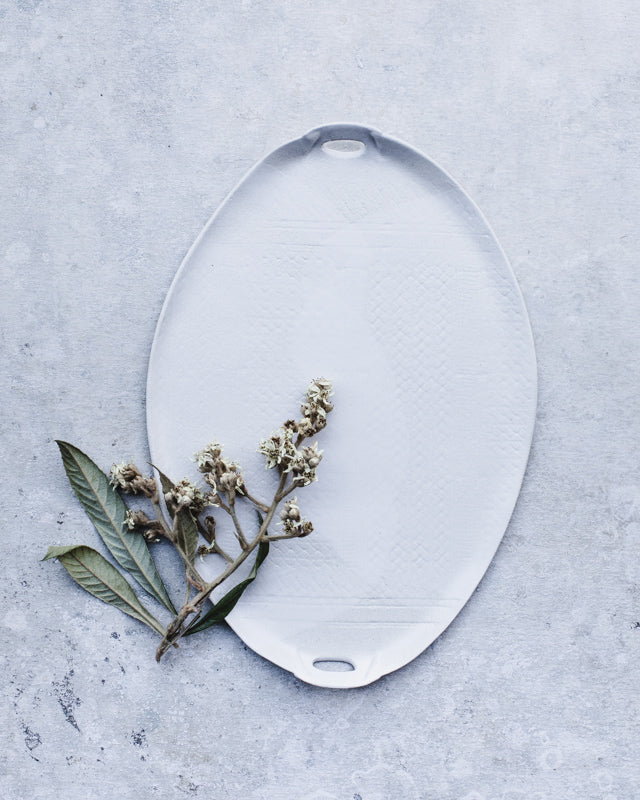 Large satin white platter with textured surface and cut out handles perfect for entertaining by clay beehive