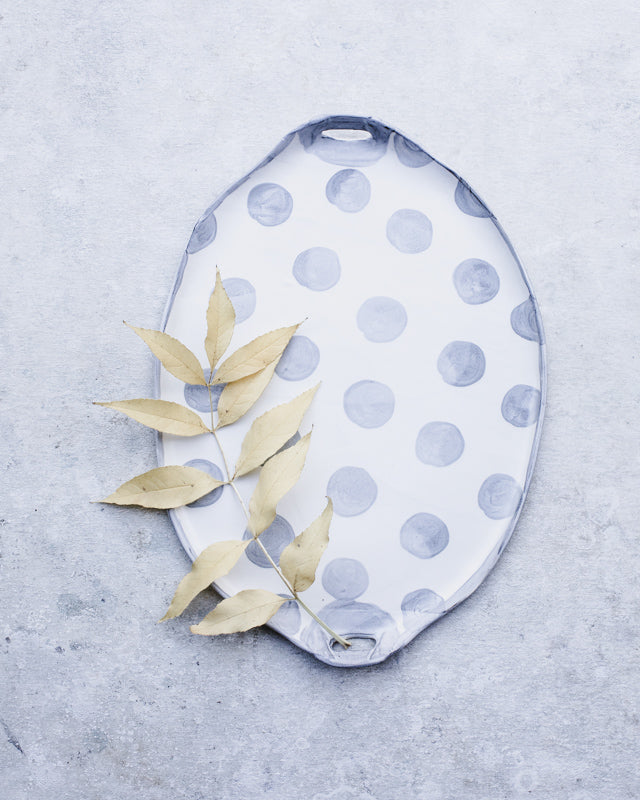 Polka dot hand made platter in grey and white with cutout handles by clay beehive ceramics