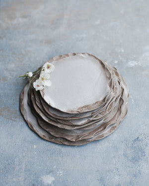 earthy organic shaped rim with satin white glazed plates by clay beehive ceramics