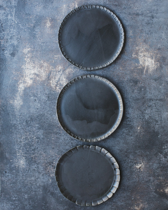 ceramic hand-made plates by clay beehive with carved rims and satin black glazing