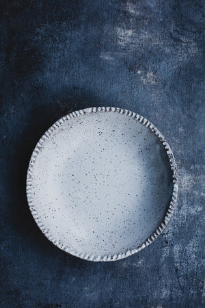 Rustic satin white speckle bowl with textured rim detail