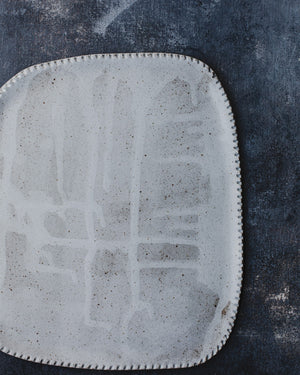Drippy White grid Platter with detailed edging by clay beehive