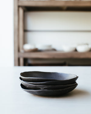 Organic shaped bowls finished in a soft satin matte black glaze