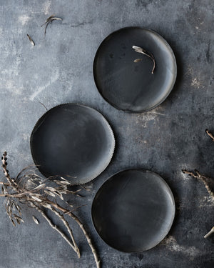Bowls with a satin matte charcoal glaze and organic shape