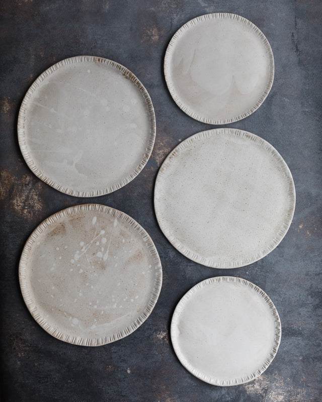 ceramic plates with carved rims beautiful satin white glazing perfect for food bloggers and food photography and food stylists