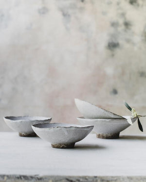 Footed matte white stoneware bowls handmade by clay beehive ceramics