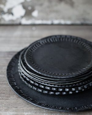 Satin matte black charcoal plates with carved rims hand made by clay beehive ceramics