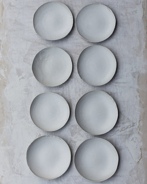 flatlay of white organic shallow bowls with satin white glaze by clay beehive ceramics