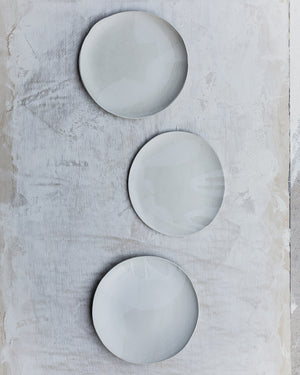 satin white plates with organic shaped curve and gritty clay by clay beehive ceramics