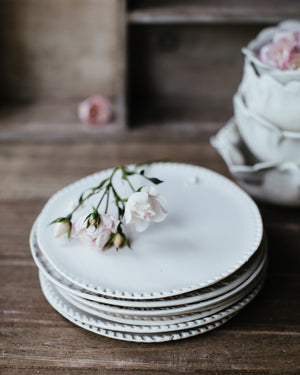 ceramic white dessert plate hand made by clay beehive ceramics with a detailed rim