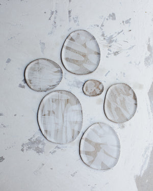 Oval rustic ceramic plates with textured edging and satin white glaze created by clay beehive ceramics