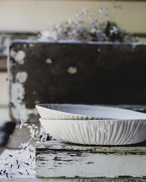 Textured satin white bowls wide and low crafted by clay beehive ceramics