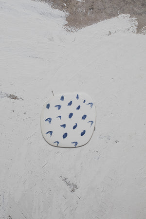 nautical inspired blue and white tiny ceramic plate