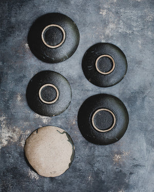 black gritty shallow footed bowls / plates ceramic by clay beehive