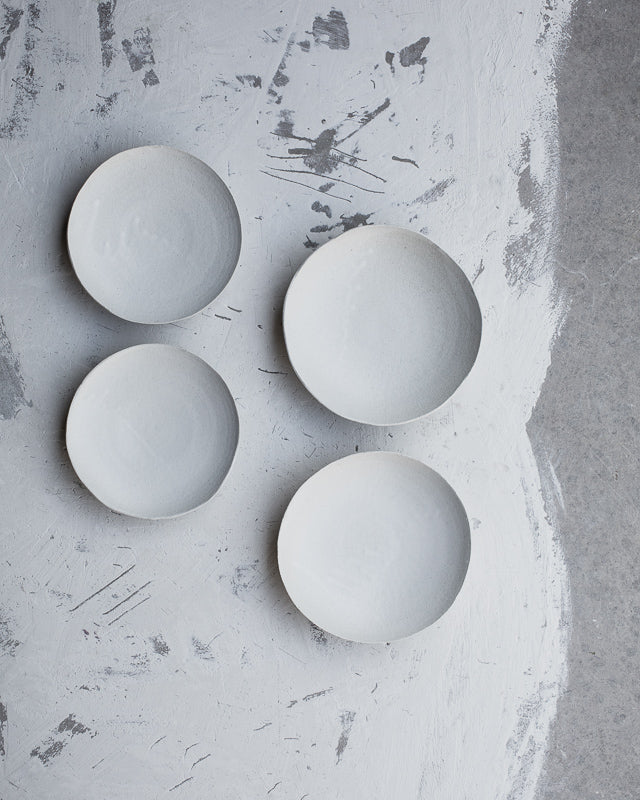 matte white footed ceramic bowls by clay beehive