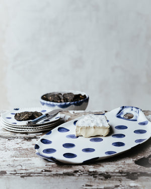 navy blue polka dot oval hand made ceramic platter with handles and perfect as a cheese board by clay beehive