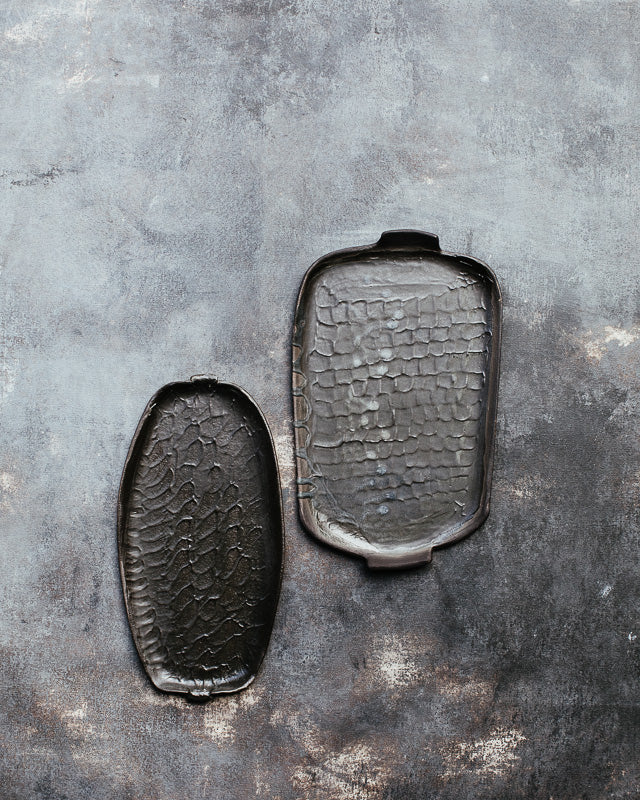 wabi sabi plates with matte black glaze and textured surface hand made by clay beehive ceramics