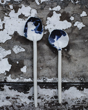 white gritty rustic hand made spoons with navy and white satin glaze by clay beehive ceramics