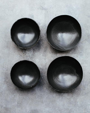 flat lay of wabi sabi footed matte black bowls deeper interior noodles soups hand made by clay beehive ceramics