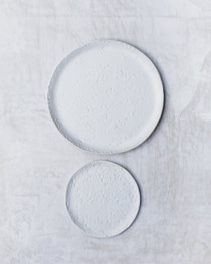 Satin white plates with texture and handmade by clay beehive ceramics