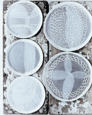 ceramic hand made plate with carved texture and pattern in grey and white matte by clay beehive