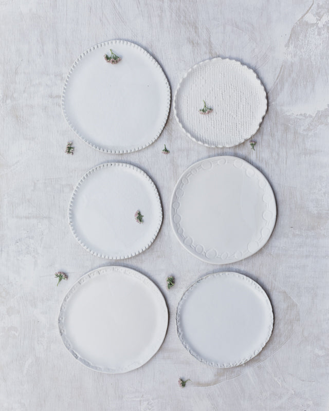 handmade ceramic cake plates in satin white with textured rims by clay beehive