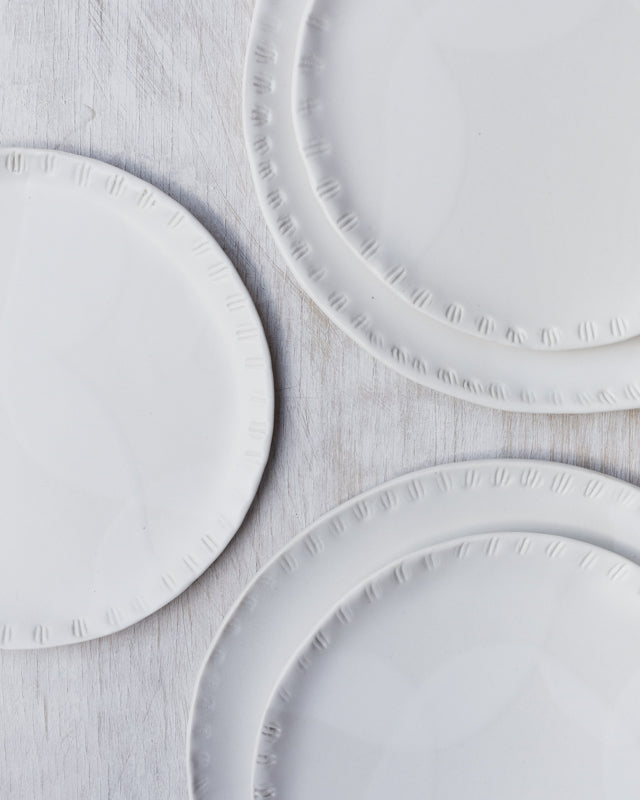 Satin white carved seashell rim plates
