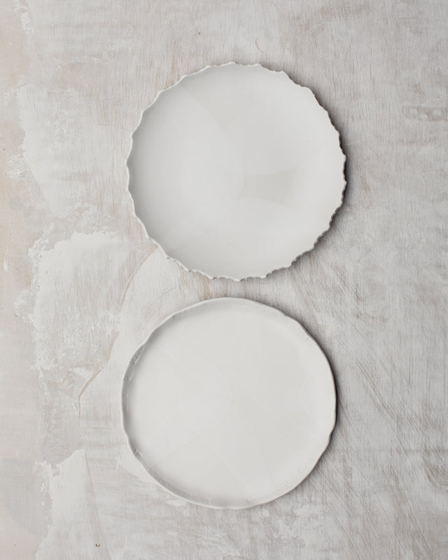 Satin white hand made plates with decorative rims by clay beehive ceramic