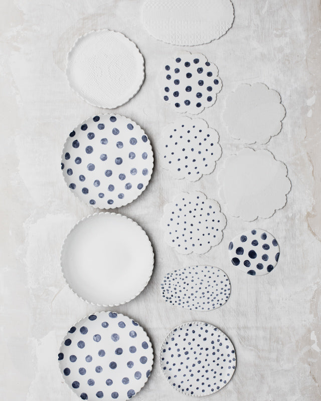 ceramic blue and white spot hand made plates with unique rims by clay beehive