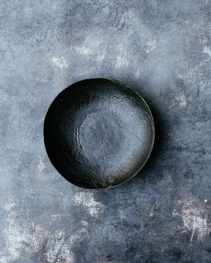 hand made footed satin black bowl with a wabi sabi vibe by clay beehive ceramics