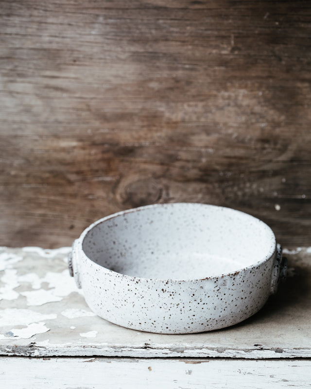 rustic ceramic dish made for baking and perfect for holding antipasto by clay beehive.