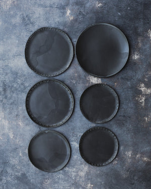 satin black hand made ceramic plates with textured rims by clay beehive
