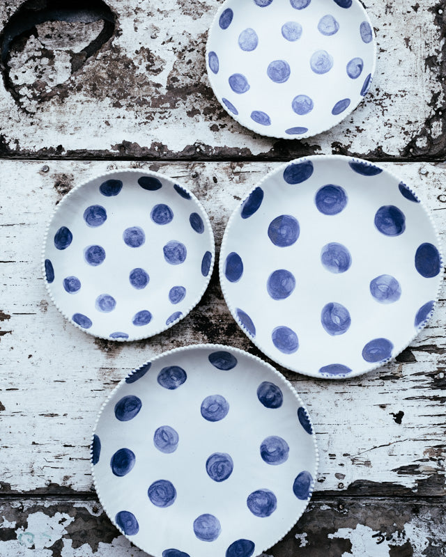 blue and white spot bowls with textured rims handmade by clay beehive ceramics.
