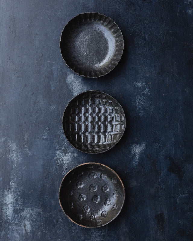 hand made ceramic bowls with heavy hand carved texture glazed in satin black by clay beehive