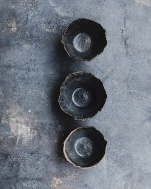 Black rustic bowls with a wabi sabi look hand made by clay beehive ceramics